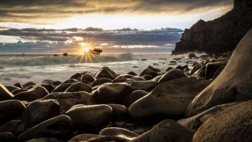 Sunrise on the seashore in New Zealand free photo