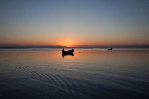 Sunset and Dusk Over the lake free photo