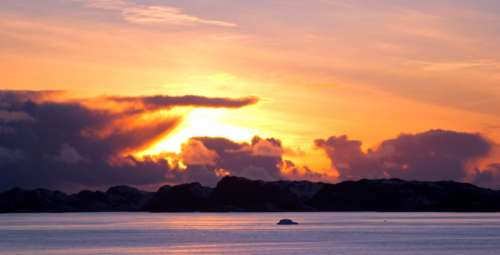 Sunset Beyond the clouds in Greenland free photo