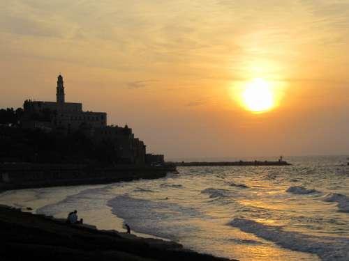 Sunset over the shoreline and ocean in Tel-Aviv, Israel free photo
