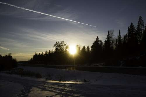 Sunset over the trees at Gooseberry Falls State Park, Minnesota free photo