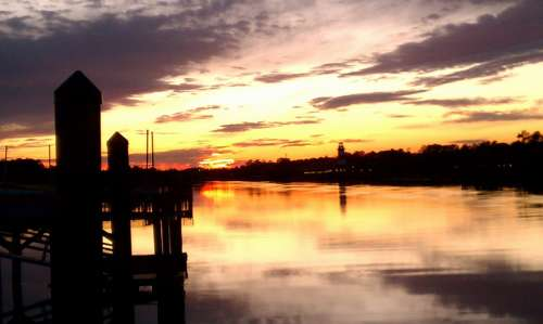 Sunset over Tranquil Waters at Myrtle Beach, South Carolina free photo