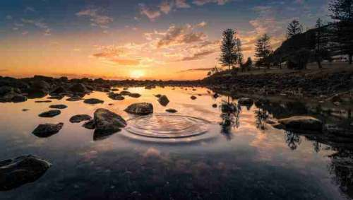 Sunset, water, and ripples landscape  free photo