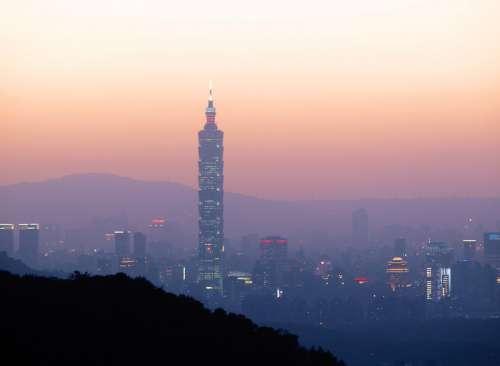 Taipei 101 at dusk under the reddish skies and haze in Taiwan free photo