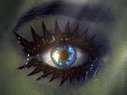 Teardrops from a crying blue eye free photo