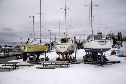Three Boats at the Marina in the winter in Grand Marais, Minnesota free photo