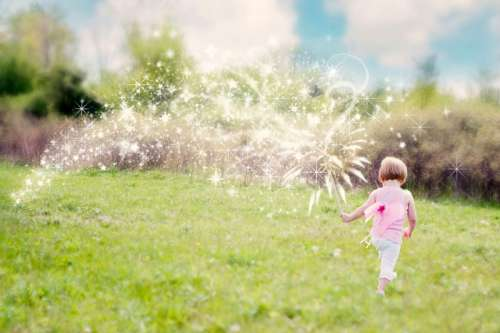 Toddler playing with magic dust free photo