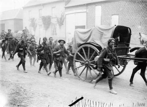 Troops of the 10th Battalion Marching towards the Battle of the Somme in World War I free photo