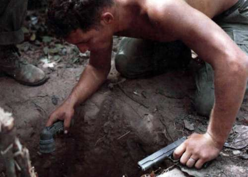 Tunnel Rat Soldier entering a Vietcong Tunnel during the Vietnam War free photo