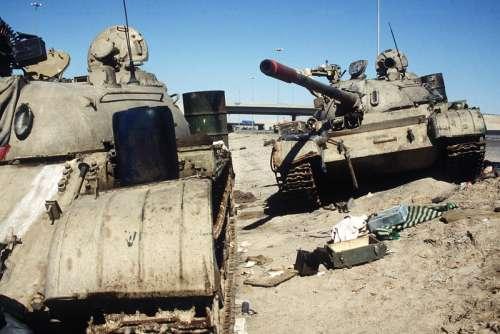 Two Iraqi tanks lie abandoned near Kuwait City in Gulf War free photo