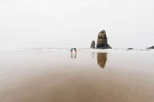 Two people on the beach in Oregon free photo