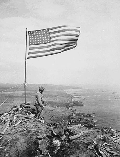 U.S. flag over Mount Suribachi in Iwo Jima, World War II free photo