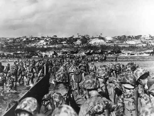 U.S. Marine reinforcements wade ashore in Okinawa, World War II free photo
