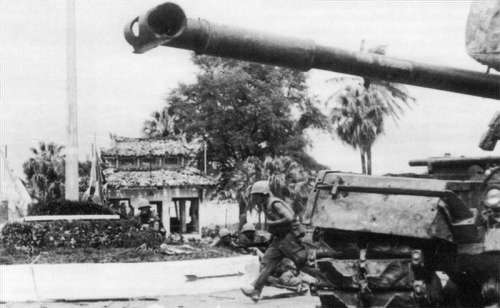 U.S. Marines advance past an M48 Patton tank during the battle for Huế during Vietnam War free photo
