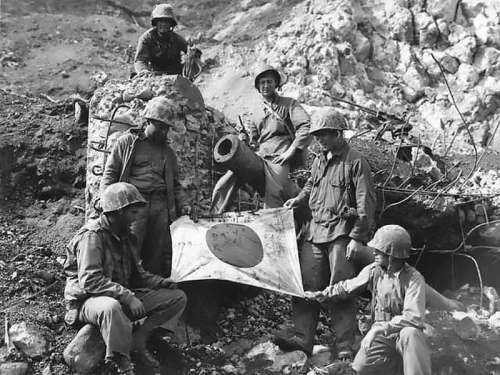 US Marines Capture Japanese Flag on top of a Pillbox at Iwo Jima free photo