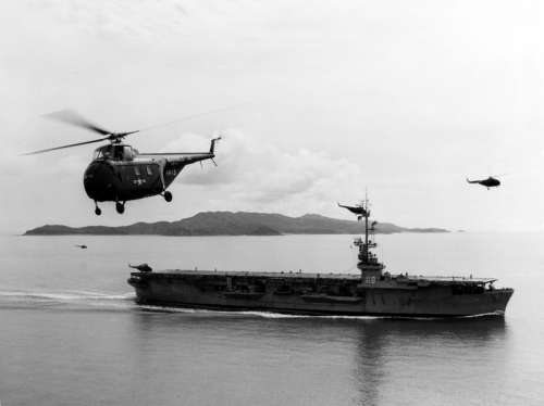 US Navy Sikorsky HO4S flying near USS Sicily during Korean War free photo