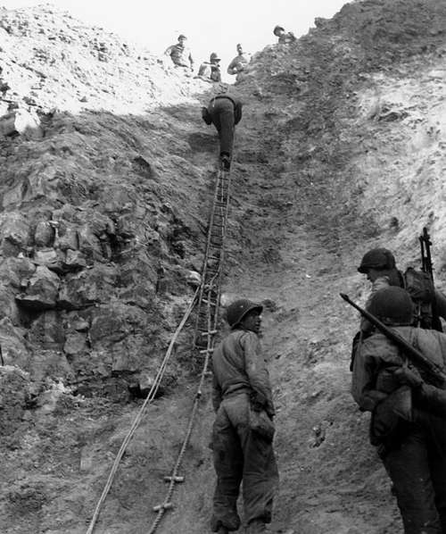 U.S. Rangers scaling the wall at Pointe du Hoc , Normandy, World War II free photo