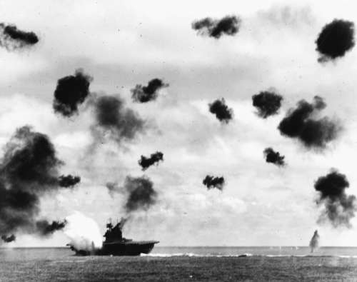 USS Yorktown being hit by a Torpedo during World War II, battle of Midway free photo
