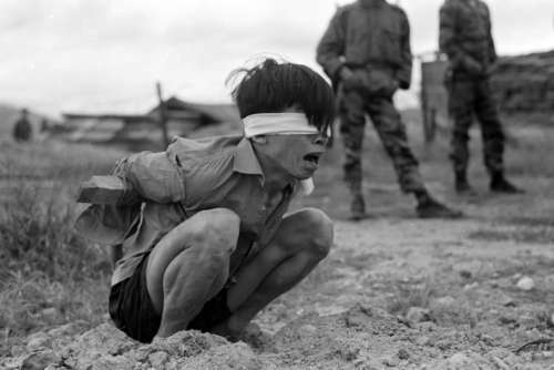 Viet Cong prisoner captured in 1967 by the U.S. Army awaits interrogation during Vietnam War free photo