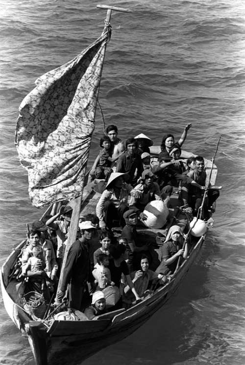 Vietnamese refugees fleeing Vietnam, 1984 in Vietnam War free photo