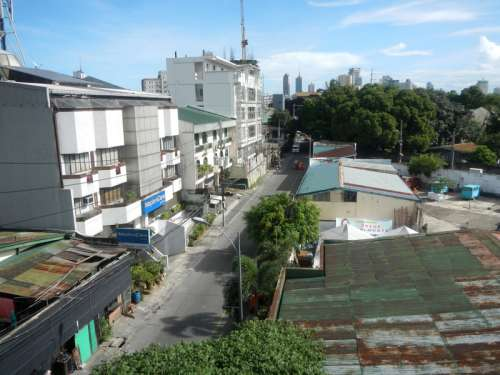 View of houses and street in Quezon City, Philippines free photo