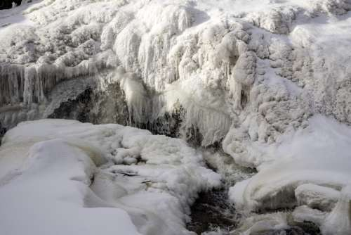 Water cascading at the frozen falls at Gooseberry Falls State Park, Minnesota free photo