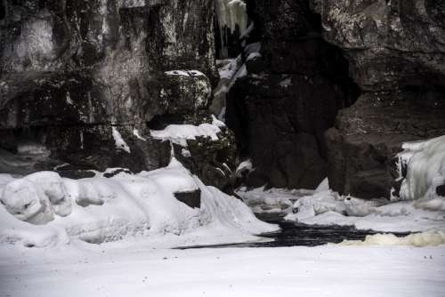 Water flowing out of the canyon with snow and ice in Temperance River State Park, Minnesota free photo