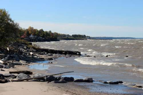 Water washing on the shores of Lake Eerie in Buffalo, New York free photo