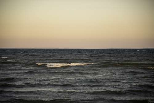Waters of Lake Michigan and horizon at Dusk at J.W. Wells State Park, Michigan free photo