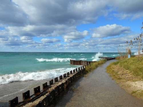 Waves crashing on shore in Michigan free photo