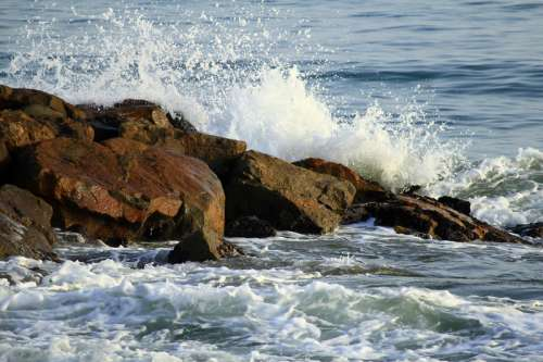 Waves crashing over the rocks in nature in Cuba free photo