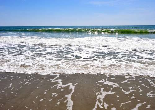 Waves washing on the beach at Myrtle Beach, South Carolina free photo