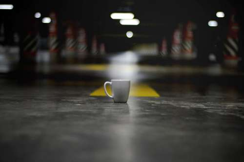 White Ceramic Coffee Cup on the ground free photo