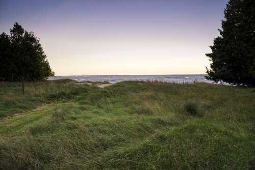 Windy Sand Dunes landscape along Lake Michigan at J.W. Wells State Park free photo