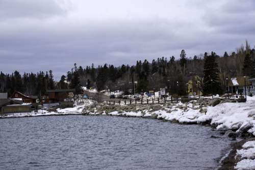 Winter shoreline and pine forest in Grand Marais, Minnesota free photo
