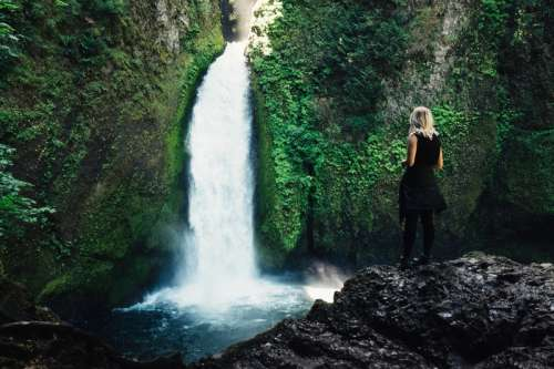 Women watching the waterfall in Oregon free photo