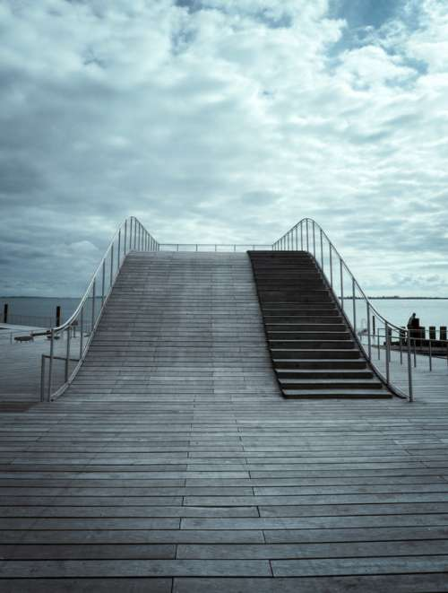 Wooden Bridge with sky and clouds in Faaborg, Denmark free photo
