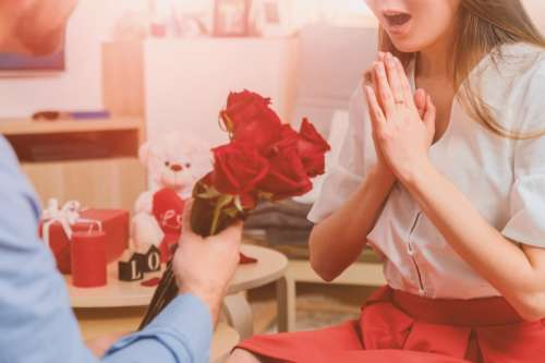 Man gives roses to woman