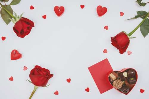 Valentine's Day. Roses, hearts and box of chocolate on white background.
