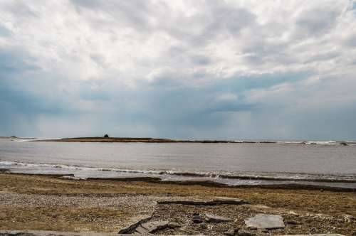 landscape of a beach in uruguay a cloudy day free image