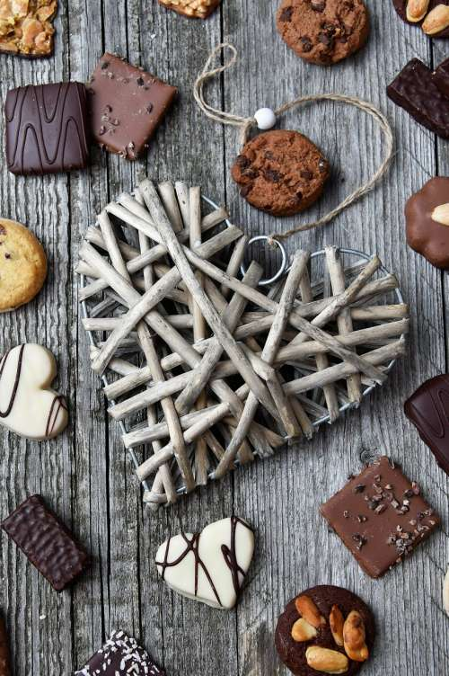 chocolate truffles on old wooden board with hearts
