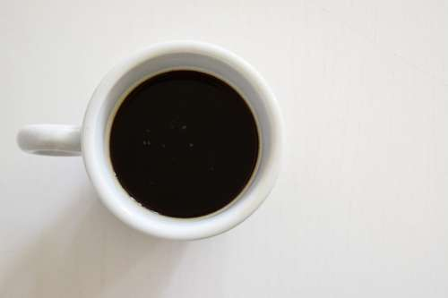 Black coffee in a white cup