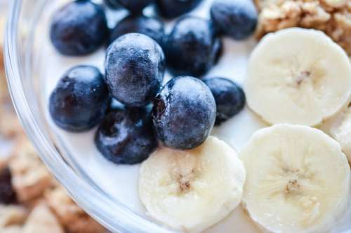 Blueberries and banana in Müsli Fitness Breakfast close up