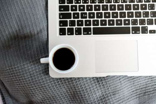 Cup off coffee on macbook