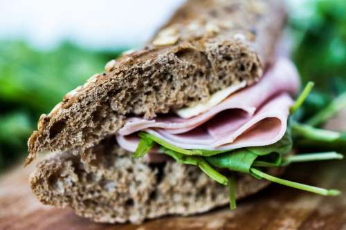 Fresh sandwich with ham and rucola