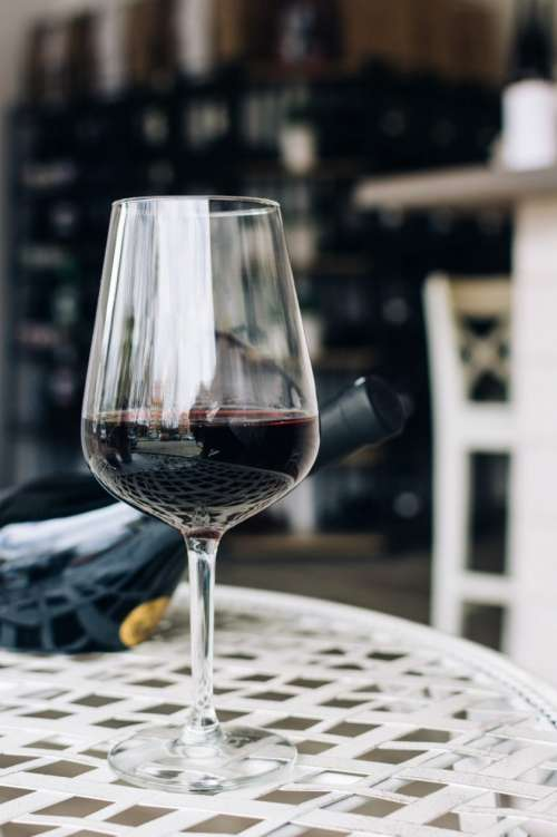 Glass with dark red wine