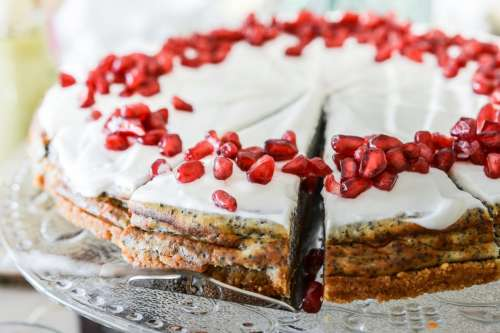 Poppy cake with pomegranate on the top
