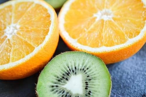Sliced orange and kiwi fruit close up