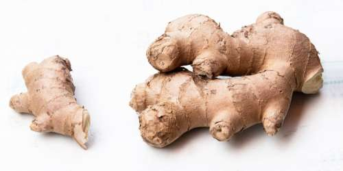Ginger pieces on white background