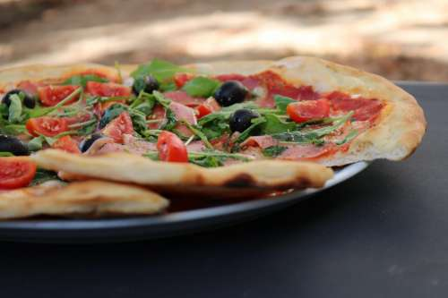 Italian pizza with olives and tomatoes